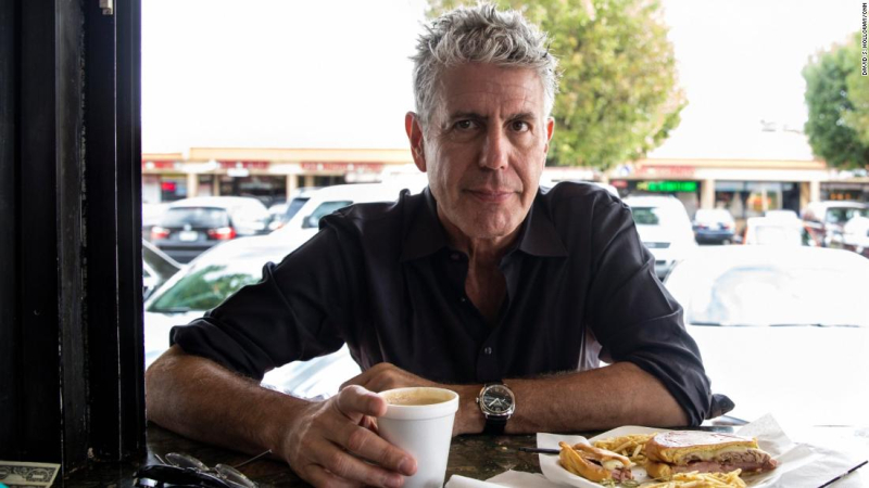 160914120051-bourdain-looking-at-camera-with-plate-of-food-super-tease
